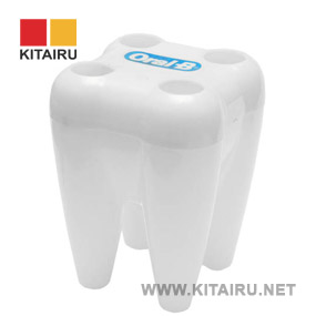 tooth shaped plastic pen holder Oral-B