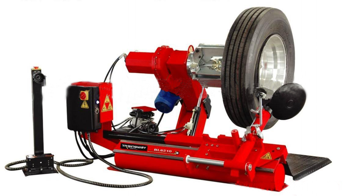 Tire changer and balancer for truck