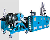 PLASTIC EXTRUDING MACHINERY