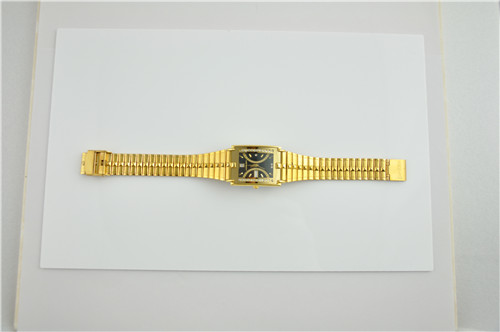 Shiny gold square brass watch with domed glass