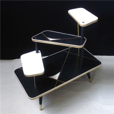 The Clothing Display Table Was Held With Two Wooden Stems And Two Brass Rods Together.