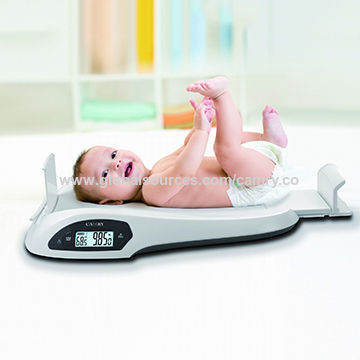 Measuring Height And Weight Of The Electronic Baby Growth Scale