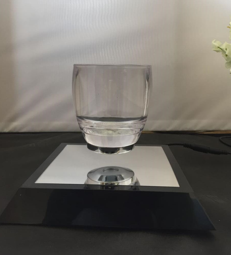 Trapezoidal base magnetic levitation floating water cup