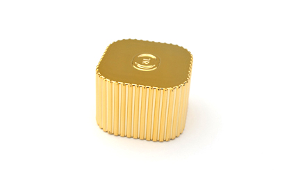 Gold plastic perfume cap with added weight