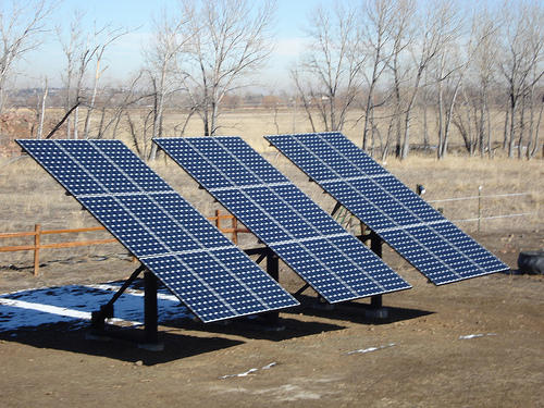 Single/double pole solar panel ground mounting system with cement block foundation