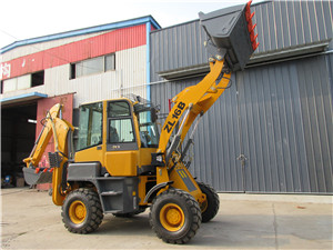 Mini backhoe loader with hydraulic hammer attachments