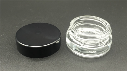 China Factory price cosmetic round jar screw neck press  glass bottle 7G manufacture