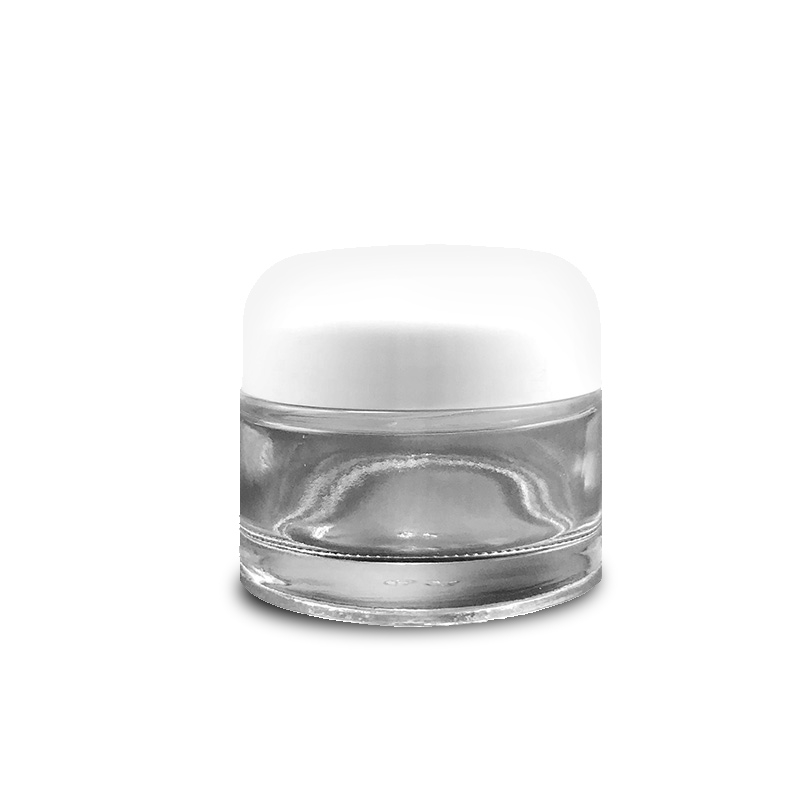 Glass cream jar with round white lid