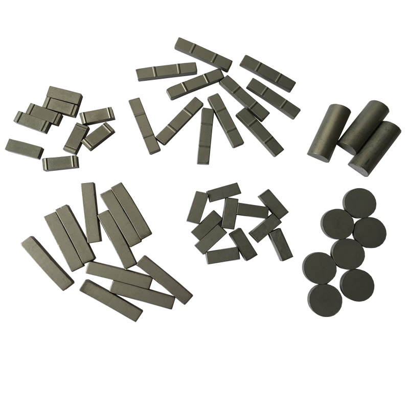 Tungsten carbide tips for oilfield stabilizers